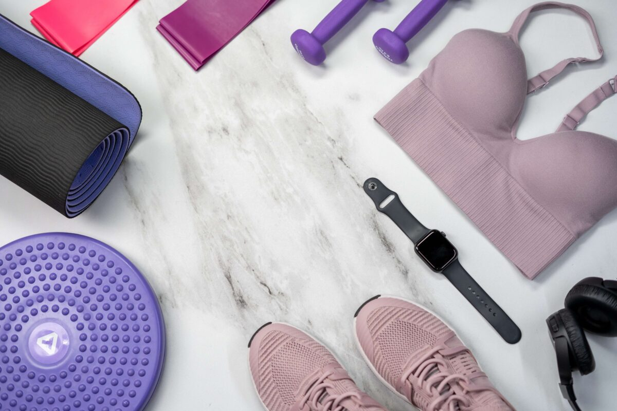 Image of an Apple Watch with gym clothing.