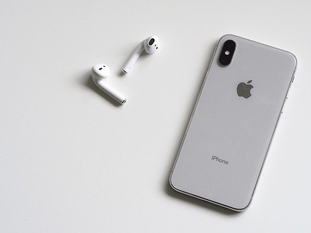 Image of AirPods with an iPhone.